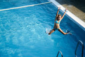 Girly pooljump — Stock Photo