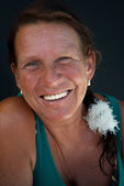 Suntanned Senior laughs heartily — Stock Photo