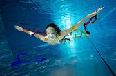 Weightless teenage girl in pool — Stock Photo