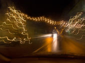 Oncoming traffic at night — Stok fotoğraf