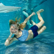 Little girl in shark tank — Stock Photo