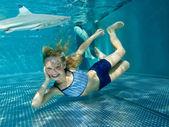 Little girl in shark tank — Stock Photo
