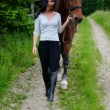 Horse and Rider walking — Stock Photo