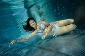 Girl floating underwater — Stock Photo