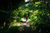 Woman on green trail — Stock Photo