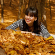 Stock Photo: Smiling girl in autumn park