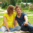 Young pretty pregnant woman with young man outdoor — Stock Photo #15655529