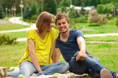 Young pretty pregnant woman with young man outdoor — Stock Photo