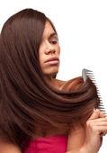 Beautiful girl with long hair combing — Stock Photo