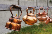 Old rusty kettles — Stock Photo