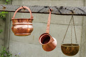 Copper pots and kettle — Stock Photo