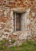 Old window with iron bars — Foto de Stock