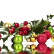 Holly berry and christmas balls — Stock Photo #11509680