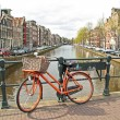 Orange bike in Amsterdam city center in the Netherlands — Stock Photo