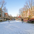 Ice skating on canals in Amsterdam Netherlands in winter — Stock Photo #13419820