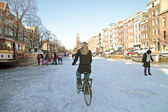 Biking on frozen canals in Amsterdam the Netherlands — Stock Photo