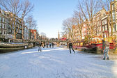 Ice skating on the canals in Amsterdam the Netherlands in winter — Stock Photo