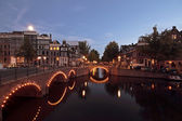 Amsterdam by night in the Netherlands — Stock Photo