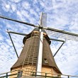 Traditional windmill in the countryside from the Netherlands - Stock Photo