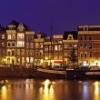 Medieval houses in Amsterdam the Netherlands at night - Stock Photo