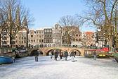 Winter in amsterdam niederlande mit der westerkerk — Stockfoto