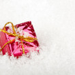 Royalty-Free Stock Photo: Christmas present in the snow