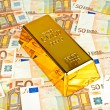 Stock Photo: Gold bar and euro money