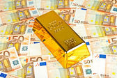 Gold bar and euro money — Stock Photo