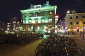 Illuminated medieval buildings in Amsterdam the Netherlands at n — Stock Photo