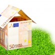 Euro money house on a piece of grass - Stock Photo