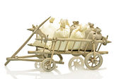 Old fashioned wooden handcart with bags of straw and potatoes — Stock Photo
