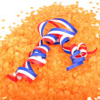 Serpentine curl in orange confetti — Stock Photo