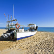 Fishing boat at the beach at Salema in Portugal — Stock Photo