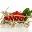 Old handcart full of tomatoes and cucumbers — Stock Photo