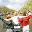 AMSTERDAM, NETHERLANDS - APRIL 30: Happy people are celebrating - Stock Photo
