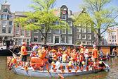 AMSTERDAM, NETHERLANDS - APRIL 30: in orange cruising thr — Stock Photo