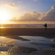 Surfer  at the beach at sunset — Stock fotografie