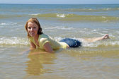 Beautiful blonde woman relaxing in the water from the north sea — Stock Photo
