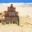 Stock Photo: House disappearing in the sand.