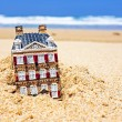 Stock Photo: House disappearing in the sand. Concept for real estate in crisi