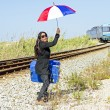 Young desperate woman at a passing train — Stock Photo