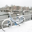 Bicycle in Amsterdam Netherlands in winter — Stock Photo #27168541