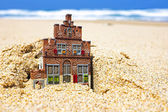 House disappearing in the sand. — Stock Photo