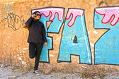 Smoking woman phoning at a graffiti wall — Stock Photo