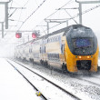 Train in snowstorm departing from Bijlmer station in Amsterdam N — Zdjęcie stockowe