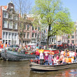 AMSTERDAM - APRIL 30: Amsterdam canals full of boats and people — Zdjęcie stockowe #28567205