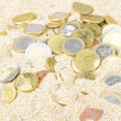 Euro coins in the sand — Stock Photo
