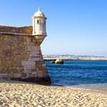 Medieval tower from Fortaleza da Ponta da Bandeira at Lagos — Stock Photo #28995761