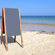 Blackboard sign at the beach — Stock Photo