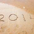 Happy New Year, 2014 written in sand at the beach — Stock Photo #29957697